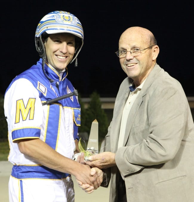 James MacDonald receives the Ontario Regional Driving Championship trophy from Grand River Raceway's Dr. Ted Clarke | Iron Horse Photo