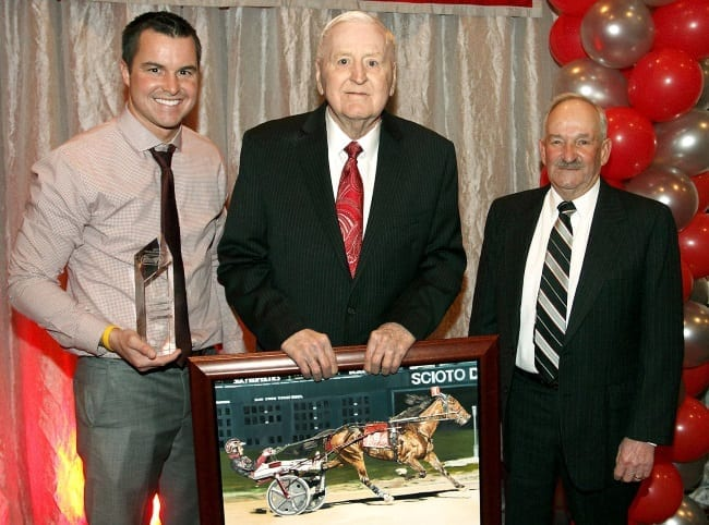 Driver Ronnie Wrenn (left), owner/breeder Keith Ross (middle) and trainer and sometimes driver Don McKirgan celebrated Like Old Times being named the 2015 Ohio Horse of the Year | Brad Conrad