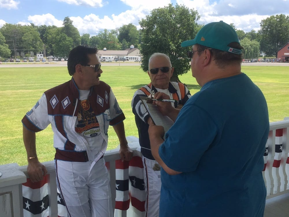 John Campbell (left) and Bill O'Donnell holding court at Goshen Historic Track on Hall of Fame Day (July 2) with writer Dave Little | Heather Wilder