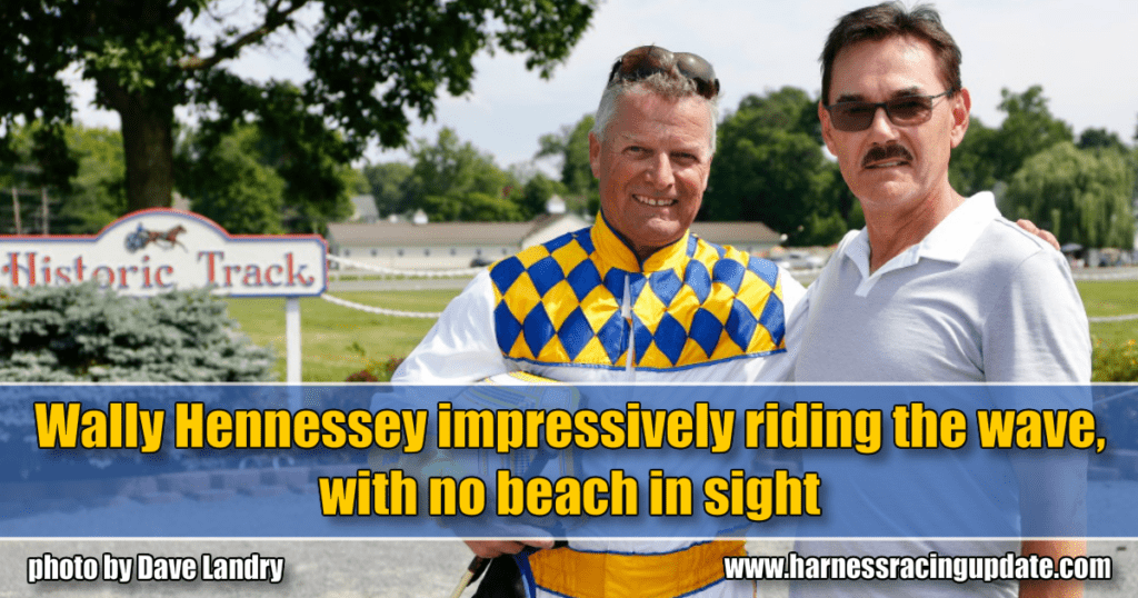 Wally Hennessey impressively riding the wave, with no beach in sight