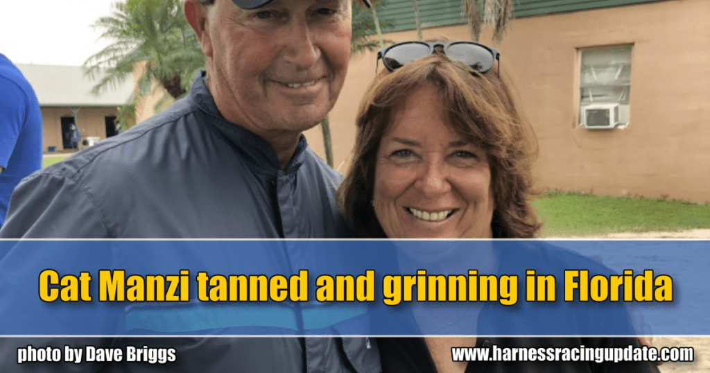Cat Manzi tanned and grinning in Florida